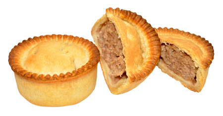 crust crusty: Two freshly baked meat pies one cut in half isolated on a white background