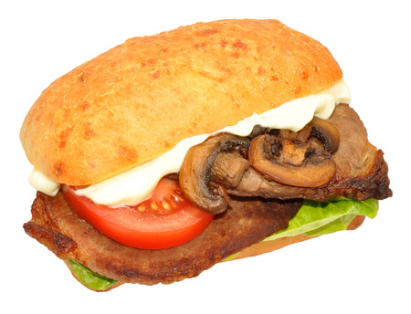 Steak sandwich with tomatoes and mushrooms isolated on a white background photo