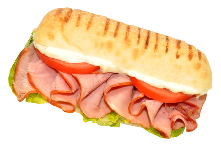 Smoked ham sandwich on a Panini bread roll isolated on a white background Archivio Fotografico