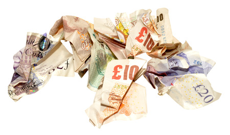 scrunched: Group of crumpled English banknotes isolated on a white background Stock Photo