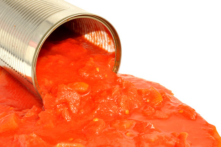 tinned: Tinned chopped tomatoes and juice isolated on a white background