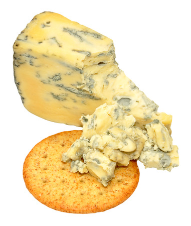 wedge: Wedge of traditional English Yorkshire blue cheese with cheese biscuits isolated on a white background