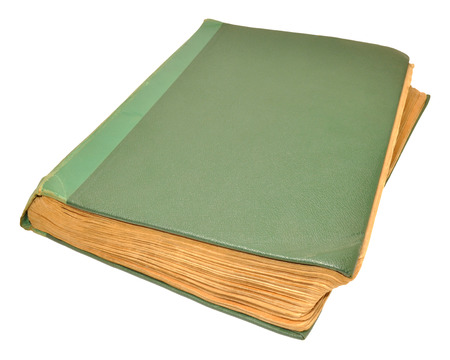 out dated: An old scruffy green hardback book isolated on a white background