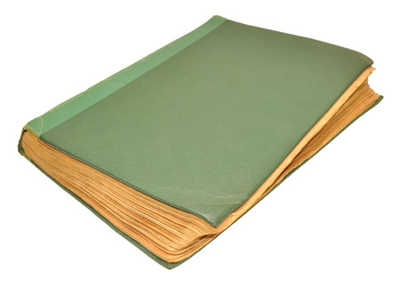 tatty: An old scruffy green hardback book isolated on a white background