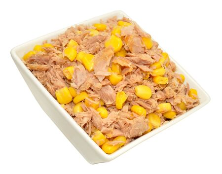 flaked: Flaked tuna fish and sweet corn mix in a dish isolated on a white background