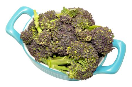 white headed: Fresh raw purple headed broccoli in a blue dish isolated on a white background