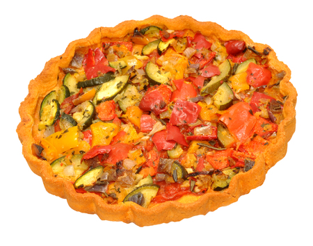 sweet and savoury: Freshly baked savoury vegetable flan filled with sweet peppers and courgette and isolated on a white background