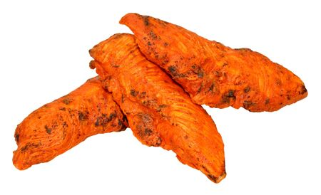 Cooked spicy tandoori chicken fillets isolated on a white background