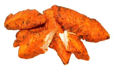 tandoori chicken: Cooked spicy tandoori chicken fillets isolated on a white background