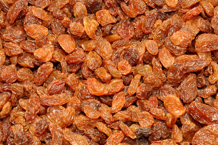 sultana: Dried golden sweet sultana fruit texture background