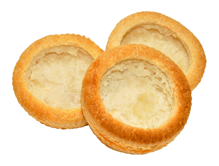 vent: Empty puff pastry vol au vent cases isolated on a white Background