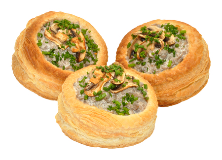 vents: Mushroom filled puff pastry vol au vents isolated on a white background