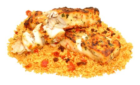 chargrill: Herb covered grilled fish fillets with couscous isolated on a white background Stock Photo