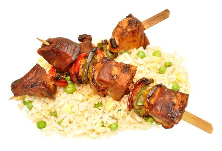 kebob: Grilled pork kebabs with sweet peppers and rice isolated on a white background
