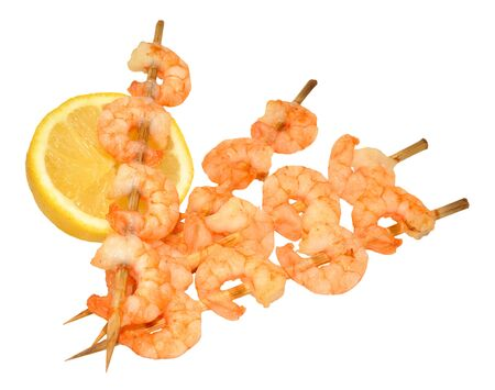 freshly cooked: Freshly cooked grilled skewered prawns isolated on a white background Stock Photo