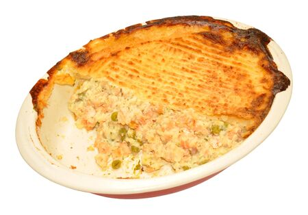 crusty: Baked fish pie with crusty mashed potato topping isolated on a white background