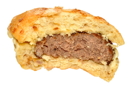 eaten: Half eaten beef burger in a bread roll isolated on a white background