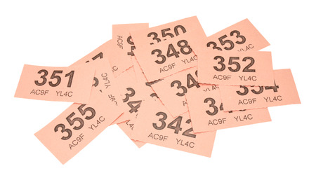 raffle: Scattered pink raffle tickets isolated on a white background