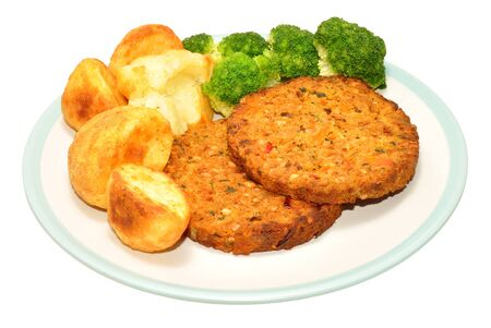 roast potatoes: Nut cutlet meal with roast potatoes and broccoli isolated on a white background