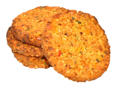 meat alternatives: Group of cooked vegetarian nut cutlets isolated on a white background