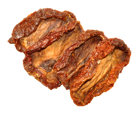 intense flavor: Wrinkled sun dried tomatoes isolated on a white background