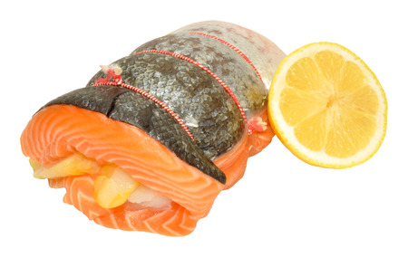 haddock: Raw three fish roast with salmon rolled around smoked haddock and cod isolated on a white background