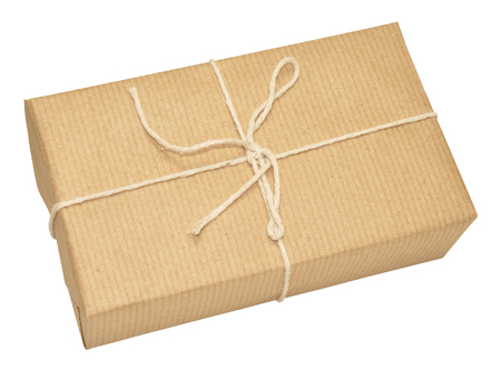 mail order: Single brown paper wrapped parcel tied with string isolated on a white background