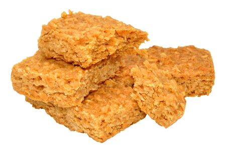 Sweet golden syrup oat flapjacks isolated on a white background