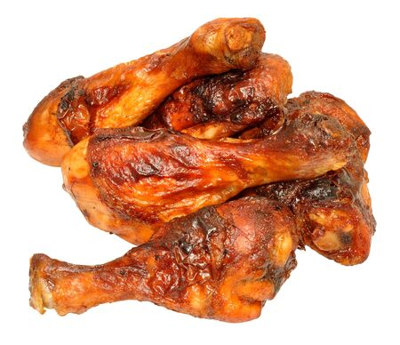 portions: Cooked chicken drumstick and thigh portions isolated on a white background