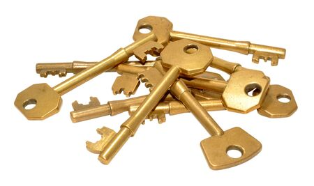 tarnished: Pile of old brass door keys isolated on a white background