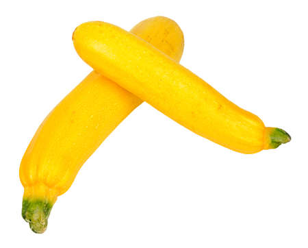 courgettes: Two ripe yellow courgettes isolated on a white background Stock Photo