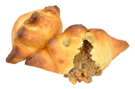 Traditional meat and potato filled pasties isolated on a white background Stock Photo