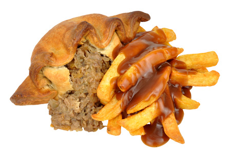 Traditional meat and potato filled pasty and chips meal isolated on a white background Stock Photo