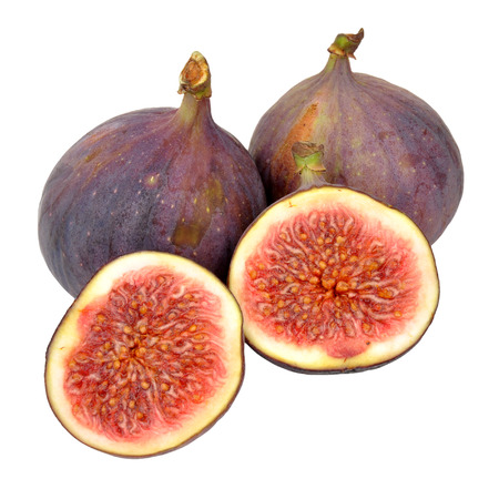 halved  half: Group of fresh fig fruits isolated on a white background