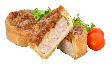 sweet and savoury: Two crusty chutney topped pork pies one cut in half with salad isolated on a white background