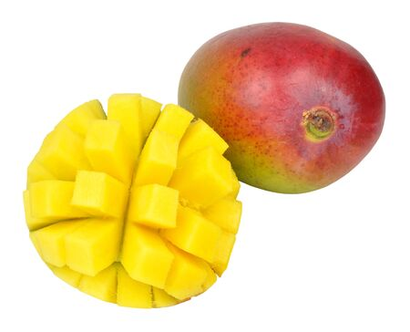 sectioned: Fresh ripe mangoes one cut in half and cubed isolated on a white background Stock Photo