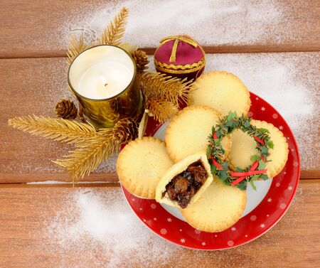 mincemeat: Traditional Christmas sweet mincemeat filled pies with festive decorations
