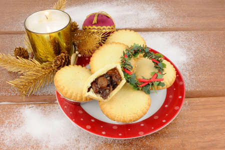 Traditional Christmas sweet mincemeat filled pies with festive decorations