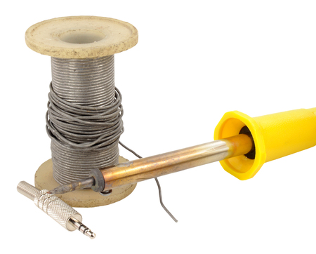 solder: Spool of old electrical and soldering iron solder isolated on a white background