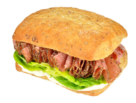 peppered: Spicy peppered salami sandwich with salad isolated on a white background