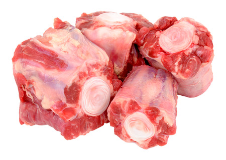 Group of cut raw oxtail bones isolated on a white background