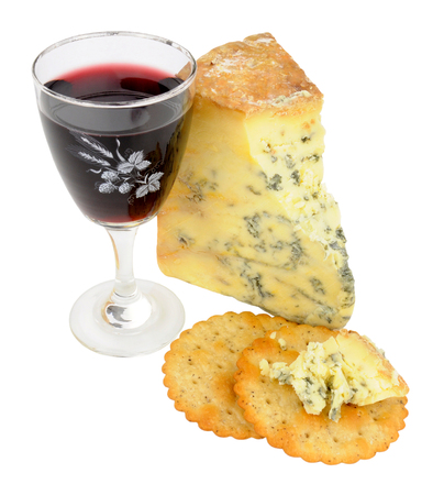 stilton: Glass of red wine and blue stilton cheese isolated on a white background
