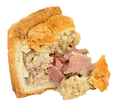 filled: Crusty salt beef filled New York deli pie isolated on a white background Stock Photo