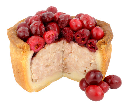 crusty: Cranberry fruit topped crusty pork pie isolated on a white background Stock Photo