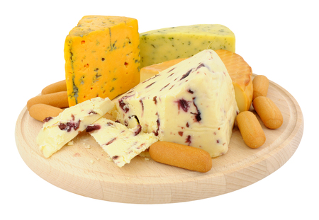 wensleydale: Round wooden cheese board with a selection of cheeses isolated on a white background Stock Photo