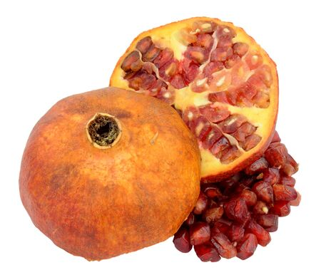 halved  half: Ripe pomegranate fruit cut in half  with seeds isolated on a white background
