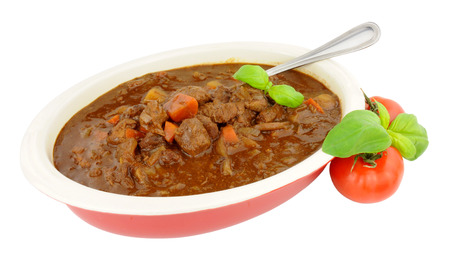 casserole dish: Beef stew in an oval casserole dish isolated on a white background