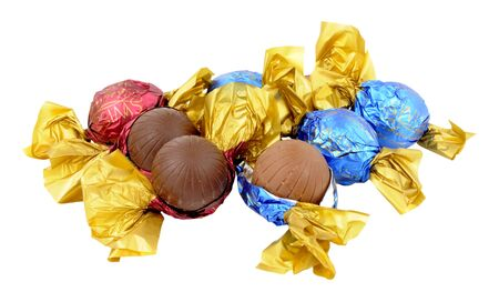 unwrapped: Group of plain and milk Swiss chocolate truffles wrapped and unwrapped isolated on a white background