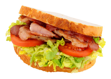 crusty: Fresh bacon and salad sandwich in crusty white sliced bread isolated on a white background Stock Photo