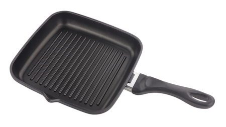 non stick: Non stick ridged griddle pan isolated on a white background Stock Photo